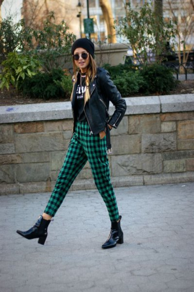 black moto jacket with knit hat and green plaid cropped pants
