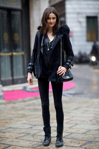 black parka jacket with leather details and ankle boots