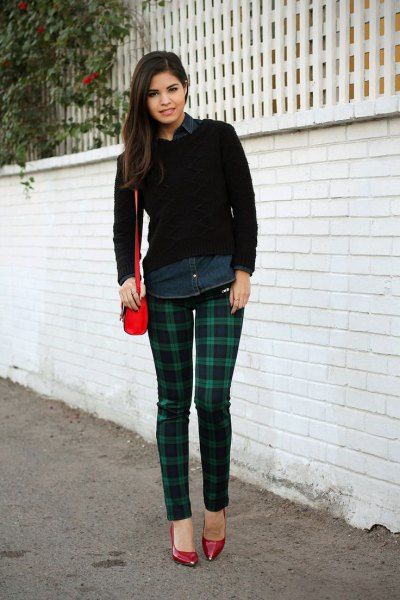black pullover sweater with navy and grey plaid skinny pants