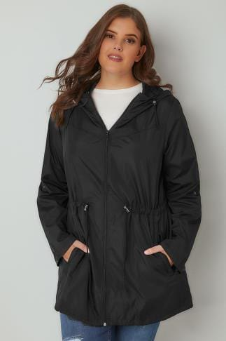 black relaxed fit parka jacket with crew neck sweater and blue jeans
