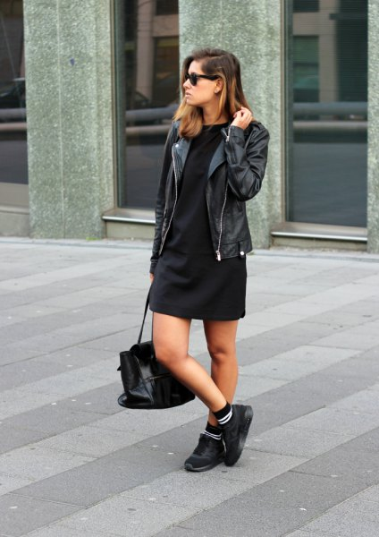 black shift mini dress with moto jacket and walking shoes