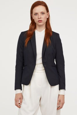 black short and fitted blazer with white high rise relaxed fit pants