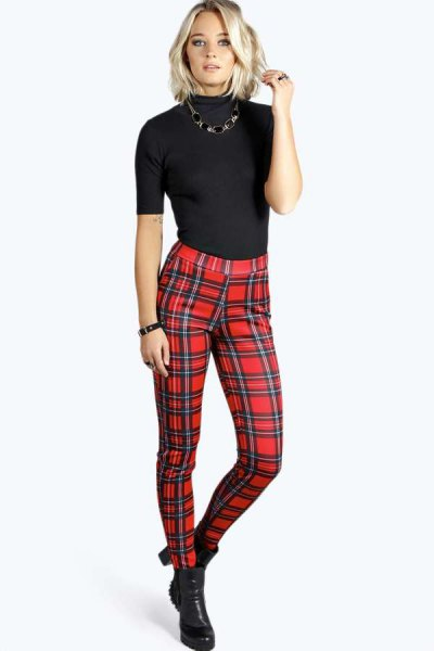 black short sleeve form fitting mock neck sweater with red high rise plaid pants