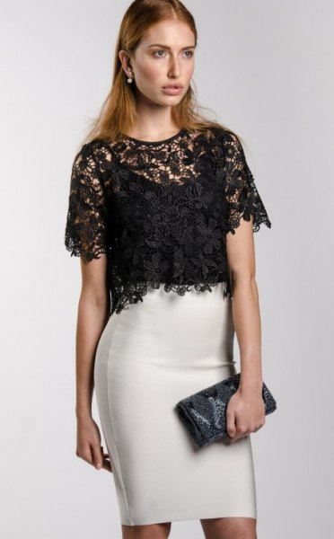 black short sleeve lace dressy blouse with white high rise mini skirt