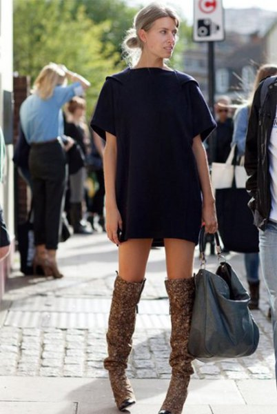 black t shirt dress with brown long flat boots