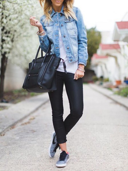 blue denim jacket with black leather pants and grey walking tennis shoes