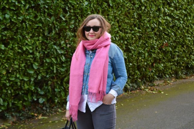 blue denim jacket with white button up shirt and shocking pink scarf