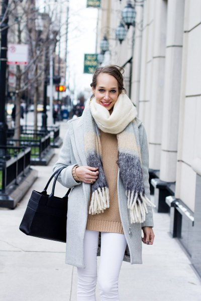 blush pink sweater with light grey wool coat and white jeans