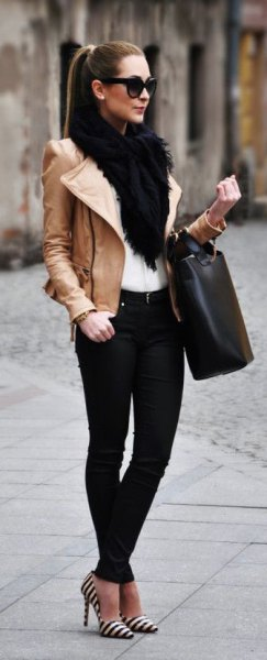 brown leather jacket with white faux fur collar and black jeans