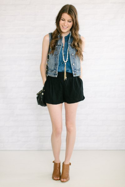 denim vest with black flowy jean shorts and open toe boots