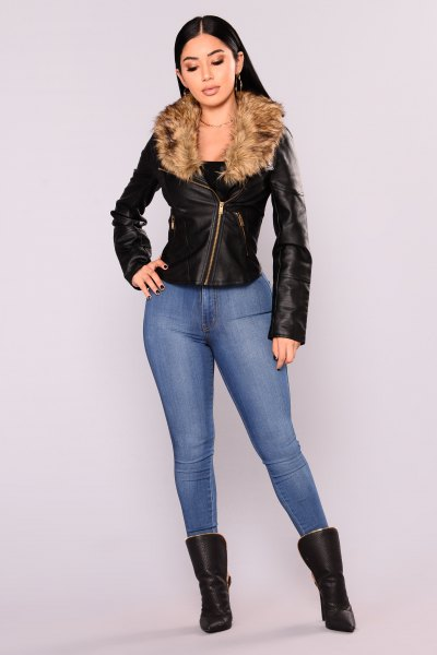 fitted moto jacket with blue skinny jeans and leather ankle boots