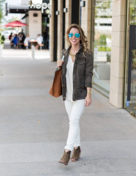grey blazer with white blouse and cuffed jeans