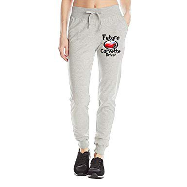 grey graphic fleece pants with black and white sneakers