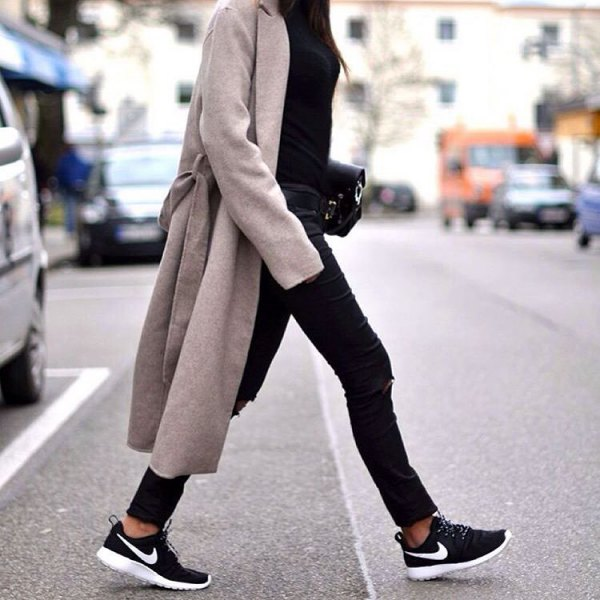 grey longline coat with black coated skinny jeans