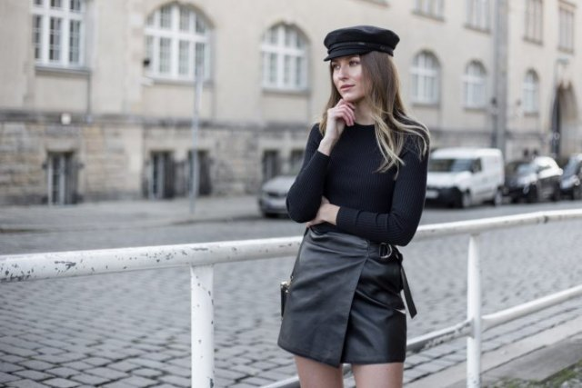 leather painters hat with long sleeve fitted tee and moto wrap mini skirt