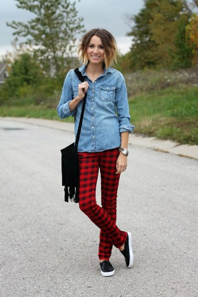 light blue button up chambray shirt with red and black plaid pants
