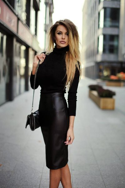 mock neck form fitting sweater with midi faux leather bodycon skirt