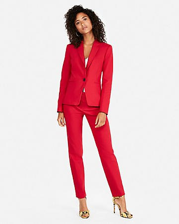 orange fitted blazer with matching ankle pants and yellow heels