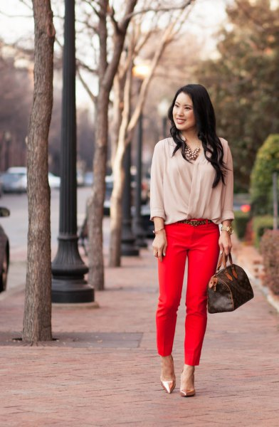pale pink blouse with red cropped pants and rose gold heels