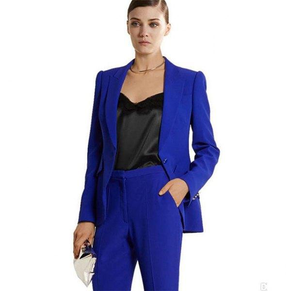 royal blue suit with black low cut silk blouse