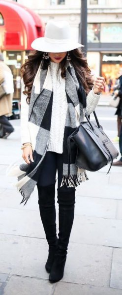 white and black plaid scarf with floppy hat and skinny jeans