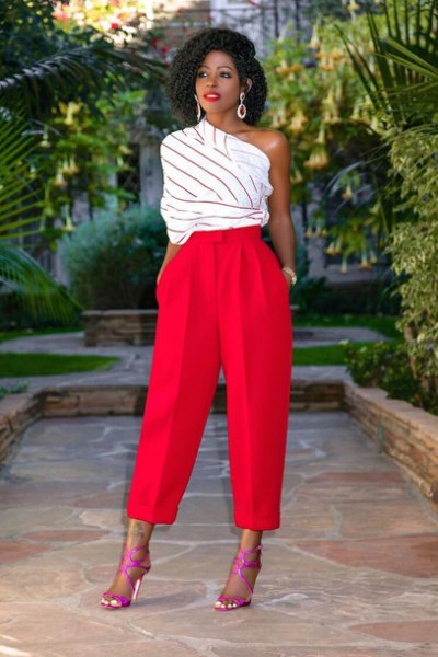 white and grey striped one shoulder top with red wide leg pants