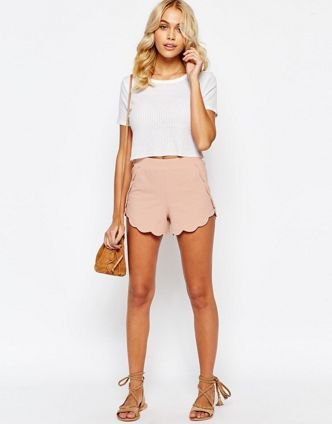 white cropped t shirt with pale pink scalloped hem shorts