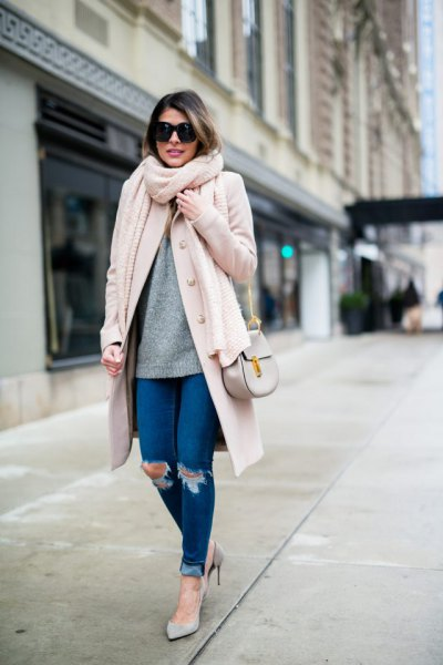white longline wool coat with blue cuffed ripped skinny jeans