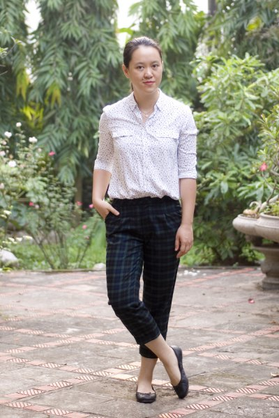 white printed blouse with dark green plaid ankle pants