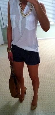 white sleeveless chiffon blouse with black designer shorts