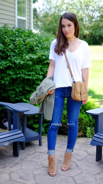 white v neck tee with blue cuffed ripped knee jeans
