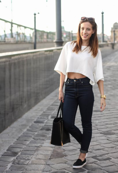 white wide sleeve cropped sweater with black cuffed jeans