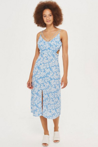 aqua blue and white floral printed v neck midi dress with white open toe shoes