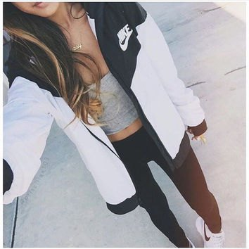 black and white color block nike windbreaker with grey crop top