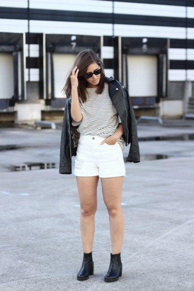 black and white striped tee with denim shorts and leather jackets