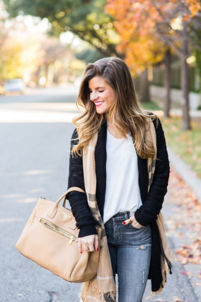 black cardigan sweater with blush pink long scarf and grey jeans