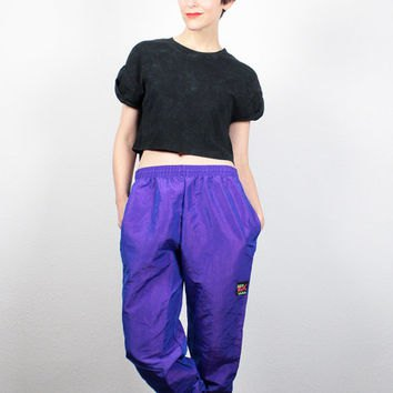 black cropped t shirt with royal blue windbreaker pants