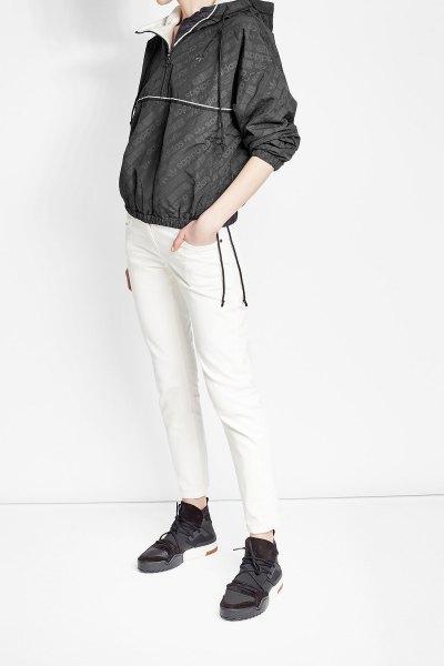 black jacket with white skinny windbreaker pants