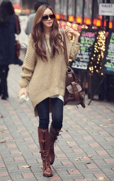 blush pink big sweater with dark blue skinny jeans and brown boots