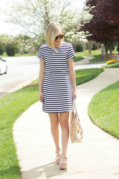 dark blue and white striped mini dress with pale pink sandals