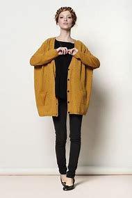 dark mustard yellow chunky cardigan sweater with black tee