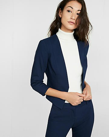 deep blue blazer with matching chinos and mock neck white sweater