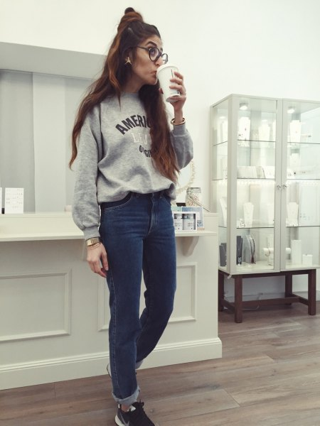 grey graphic sweatshirt with blue cuffed mom jeans