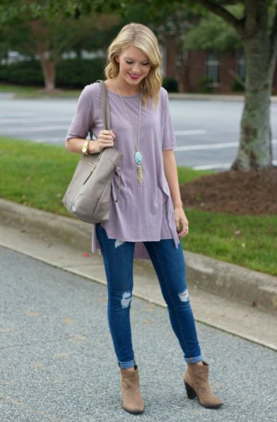 grey tunic t shirt with blue cuffed ripped skinny jeans and brown suede ankle boots