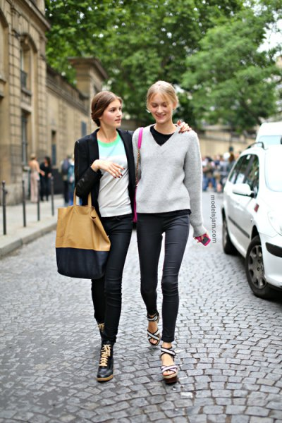 grey v neck sweater with black crew neck tee and dark jeans
