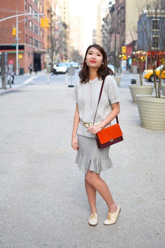 light grey sweater with matching ruffle hem knee length skirt