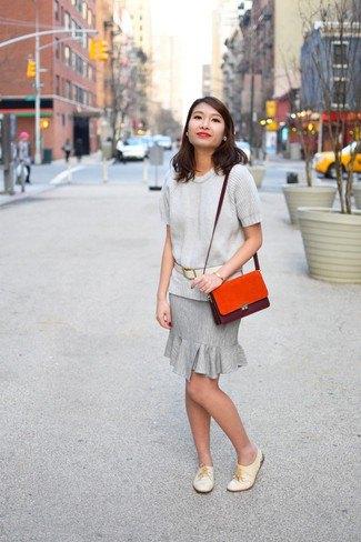light grey sweater with matching ruffle hem knee length skirt