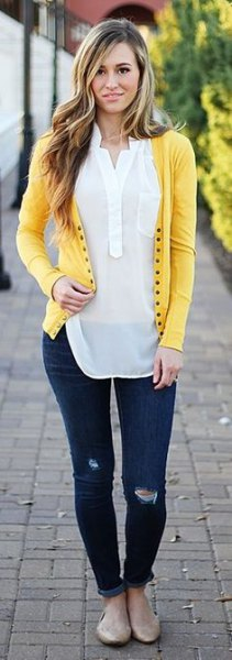 light yellow cardigan with white semi sheer polo shirt