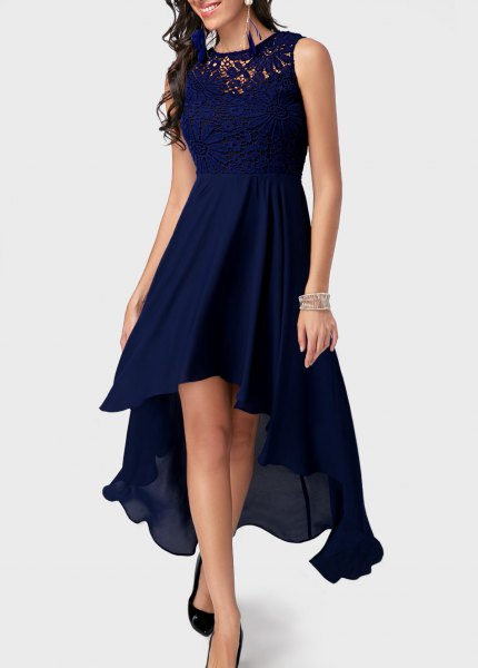 navy blue high low maxi gown with silver sequin bracelet