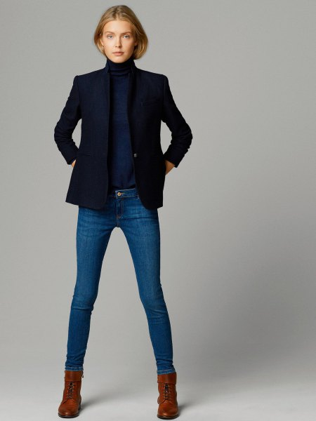 navy blue mock neck pullover sweater with matching jacket and skinny jeans